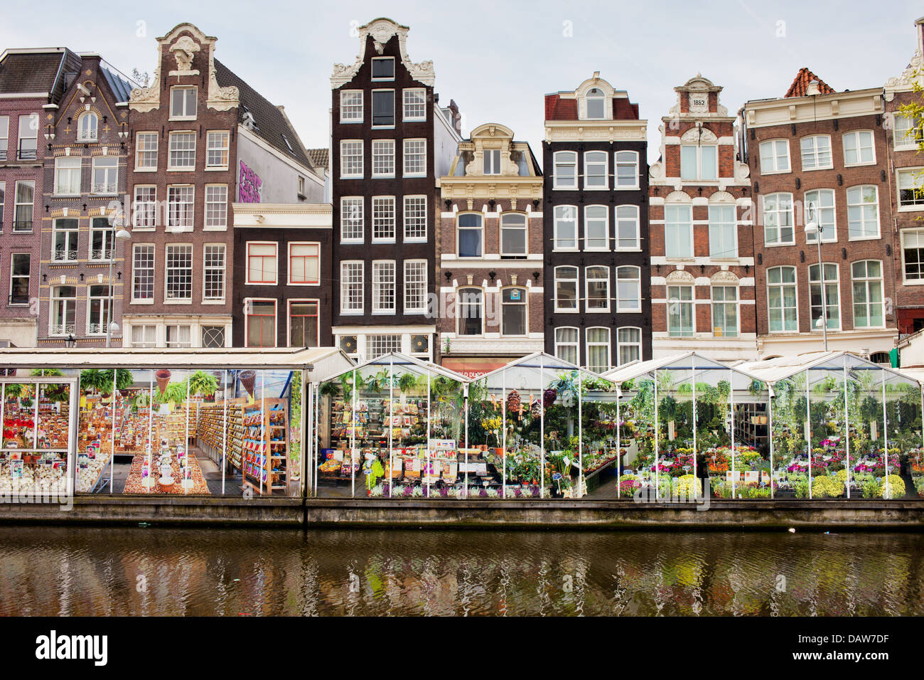 Floating Flower Market along Singel canal and Dutch style historic houses in Amsterdam, Netherlands, North Holland. - Stock Image