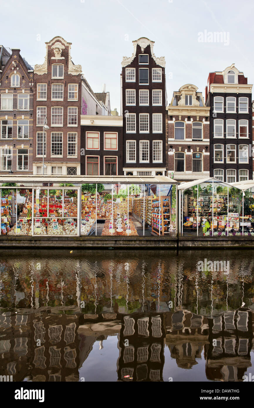 Floating Flower Market and Dutch style historic houses in Amsterdam, Netherlands, North Holland. - Stock Image