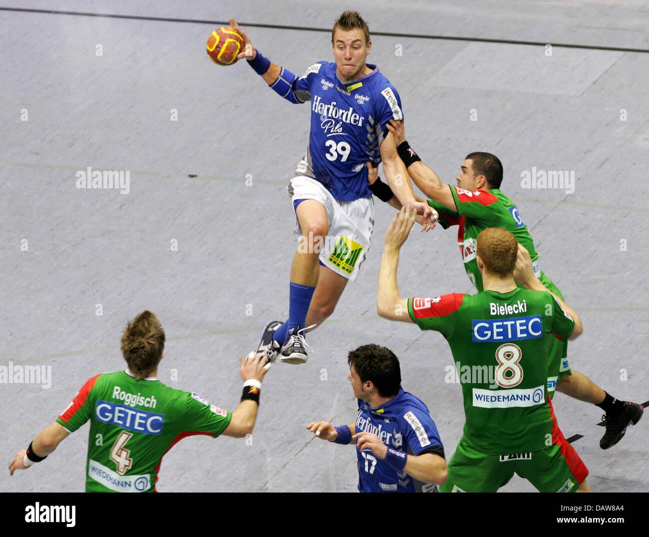 Filip Jicha (C) of Lemgo delivers the ball during the Handball Bundesliga match SC Magdeburg v TBV Lemgo at the - Stock Image