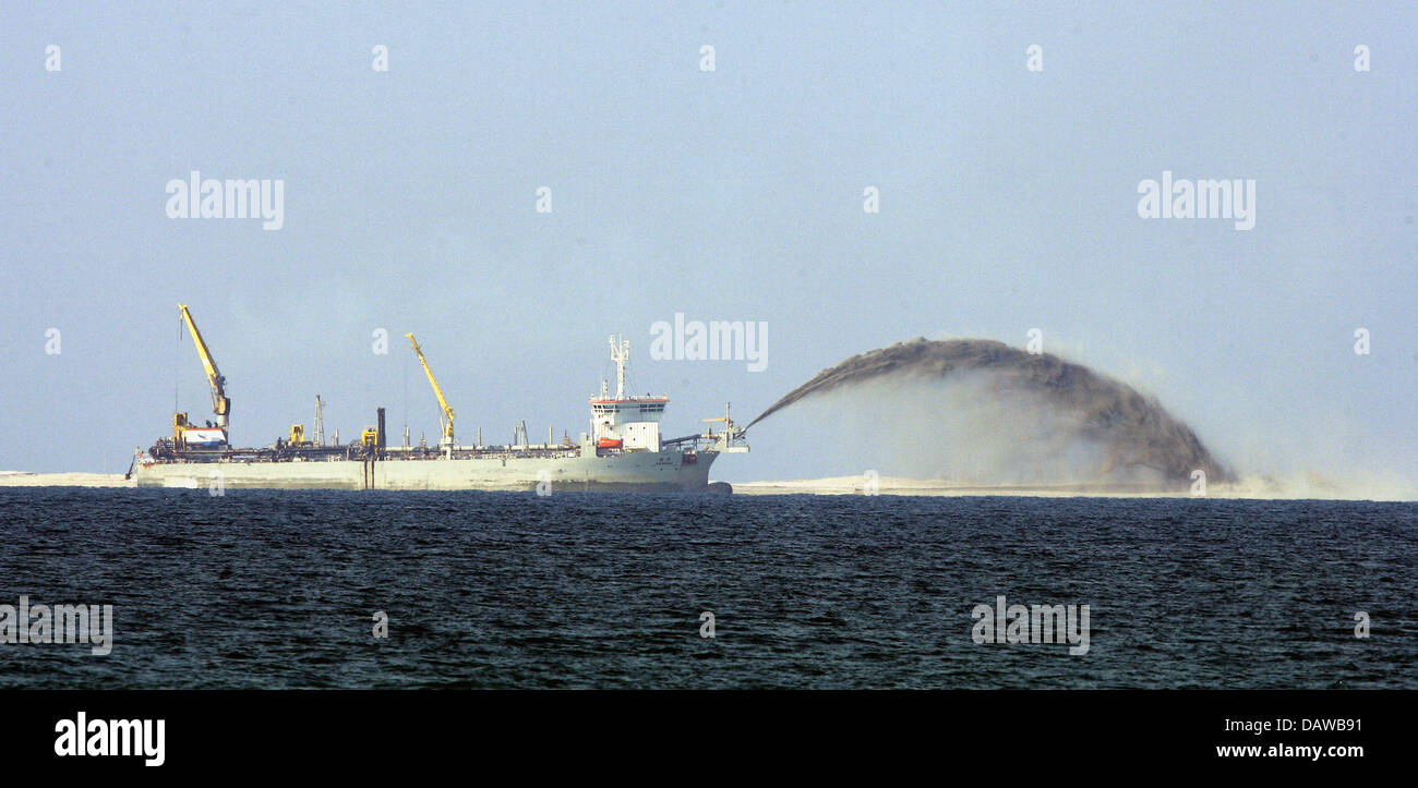 Sand is blown from a ship onto the artificial island the world sand is blown from a ship onto the artificial island the world under construction at the dubai coast uae 08 january 2007 upon its completion scheduled gumiabroncs Gallery