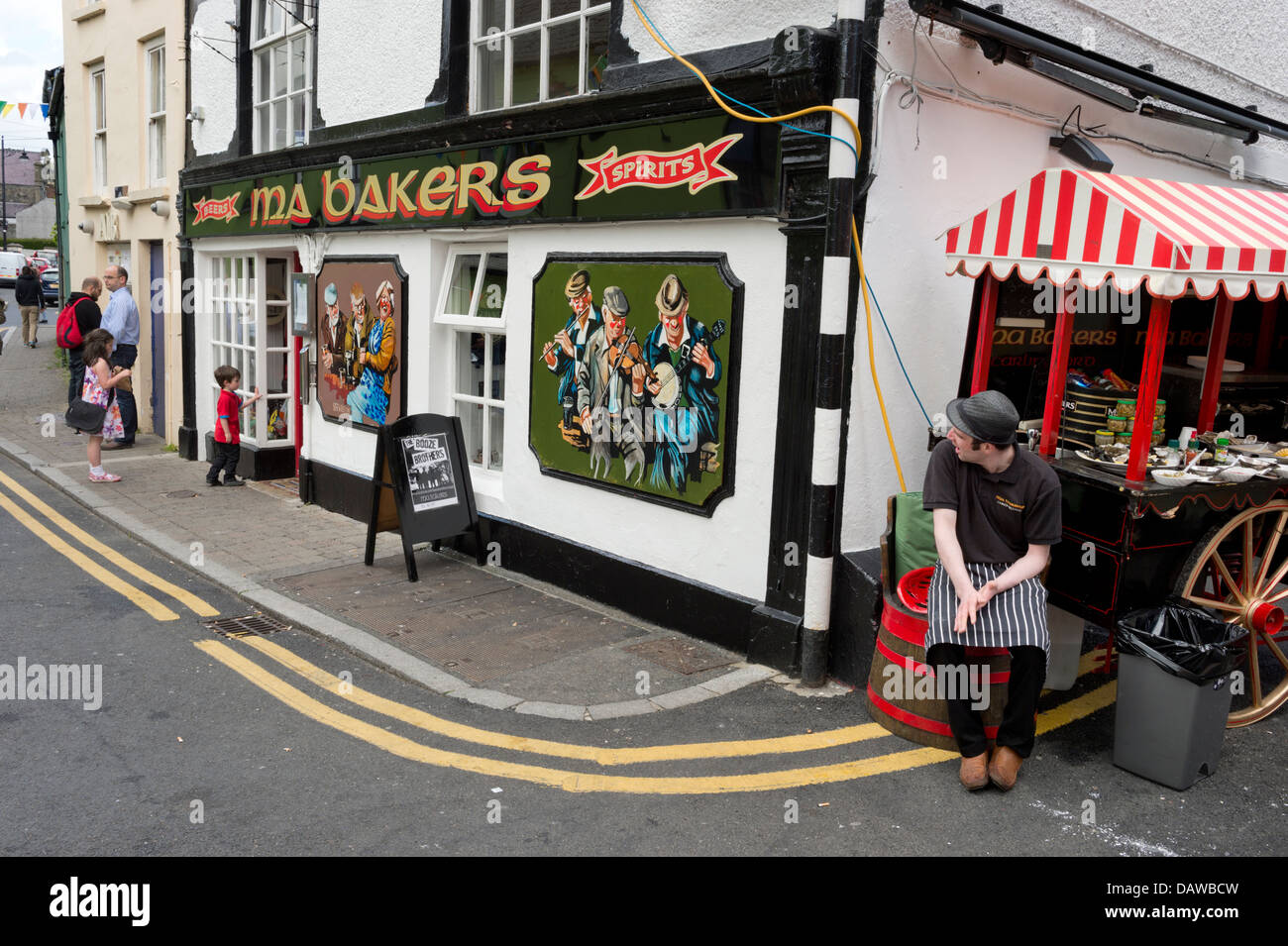 Pub and stall on street corner, at Carlingford Pipe Band Gathering Festival, Carlingford, Irish Republic Stock Photo