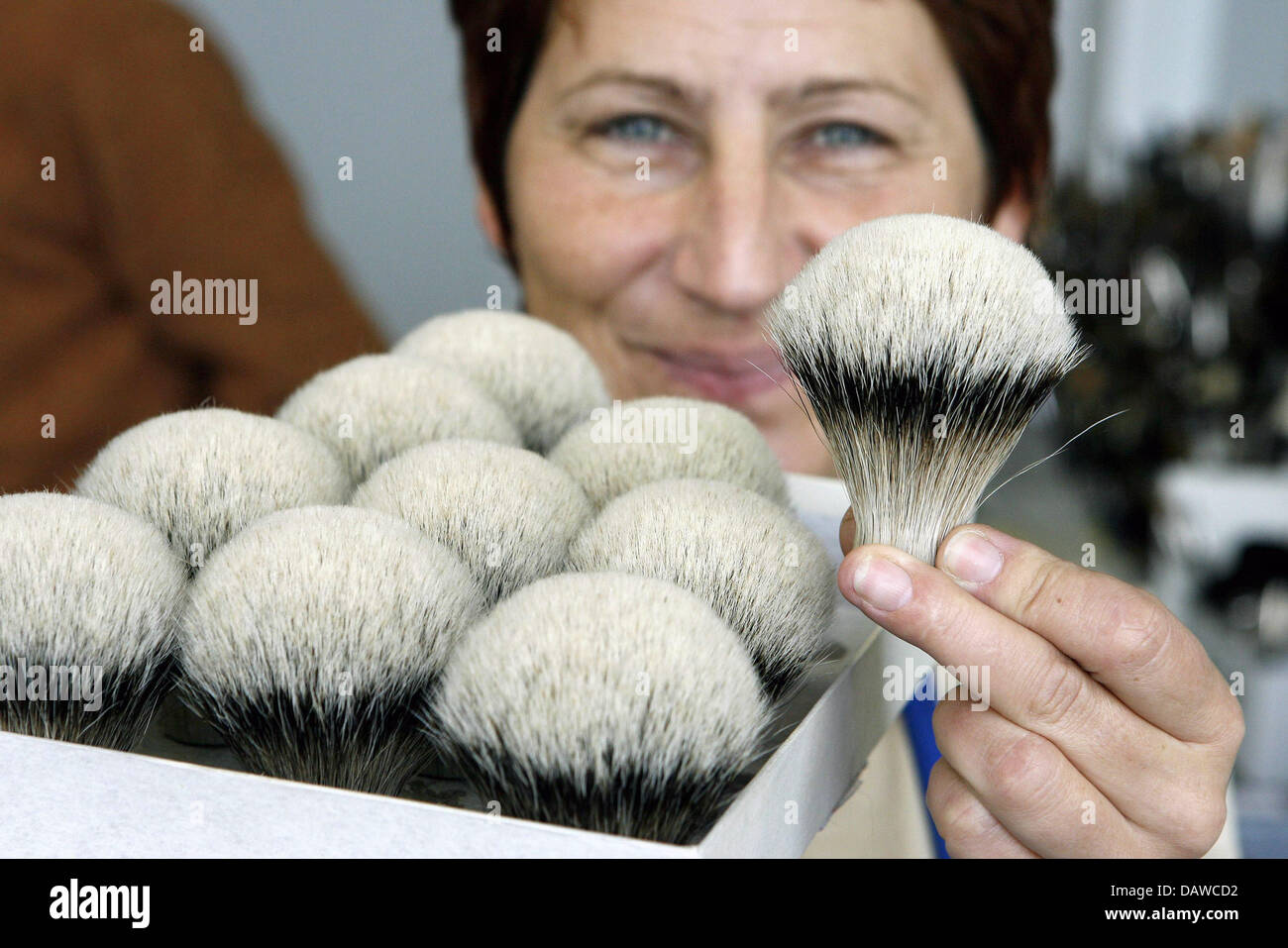 Manuela Scharf, pinselmaking mastress, presents cosmetic brushes of the artist's brush factory Defet Gmbh at the Stock Photo