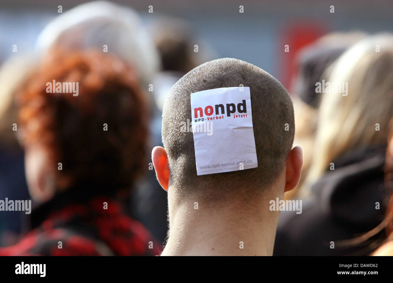 Counterdemonstrators protest a rally of rightist-extremist party NPD in Luebeck, Germany, Saturday, 31 March 2007. Stock Photo
