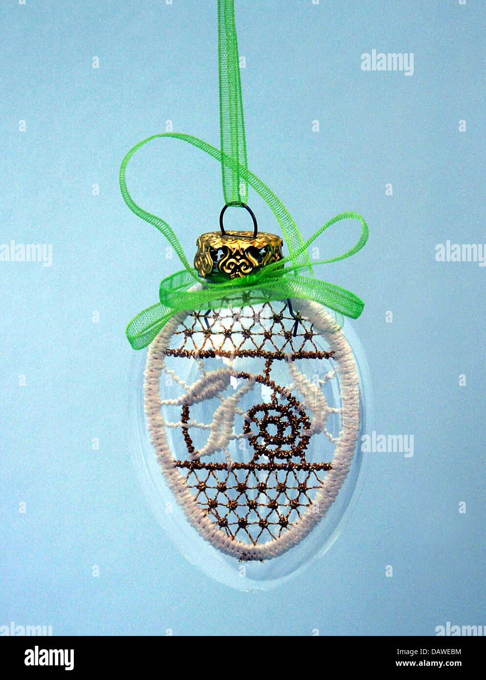 A vitreous Easter egg filled with Plauener lace pictured in Berlin, Germany, 24 March 2007. Photo: Xamax - Stock Image