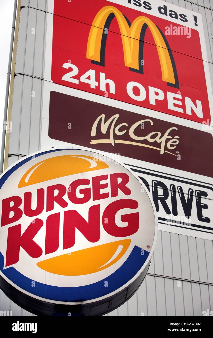 The logos of leading fast food chains Burger King (bottom) and McDonald's (top) pictured in Hamburg, Germany, - Stock Image