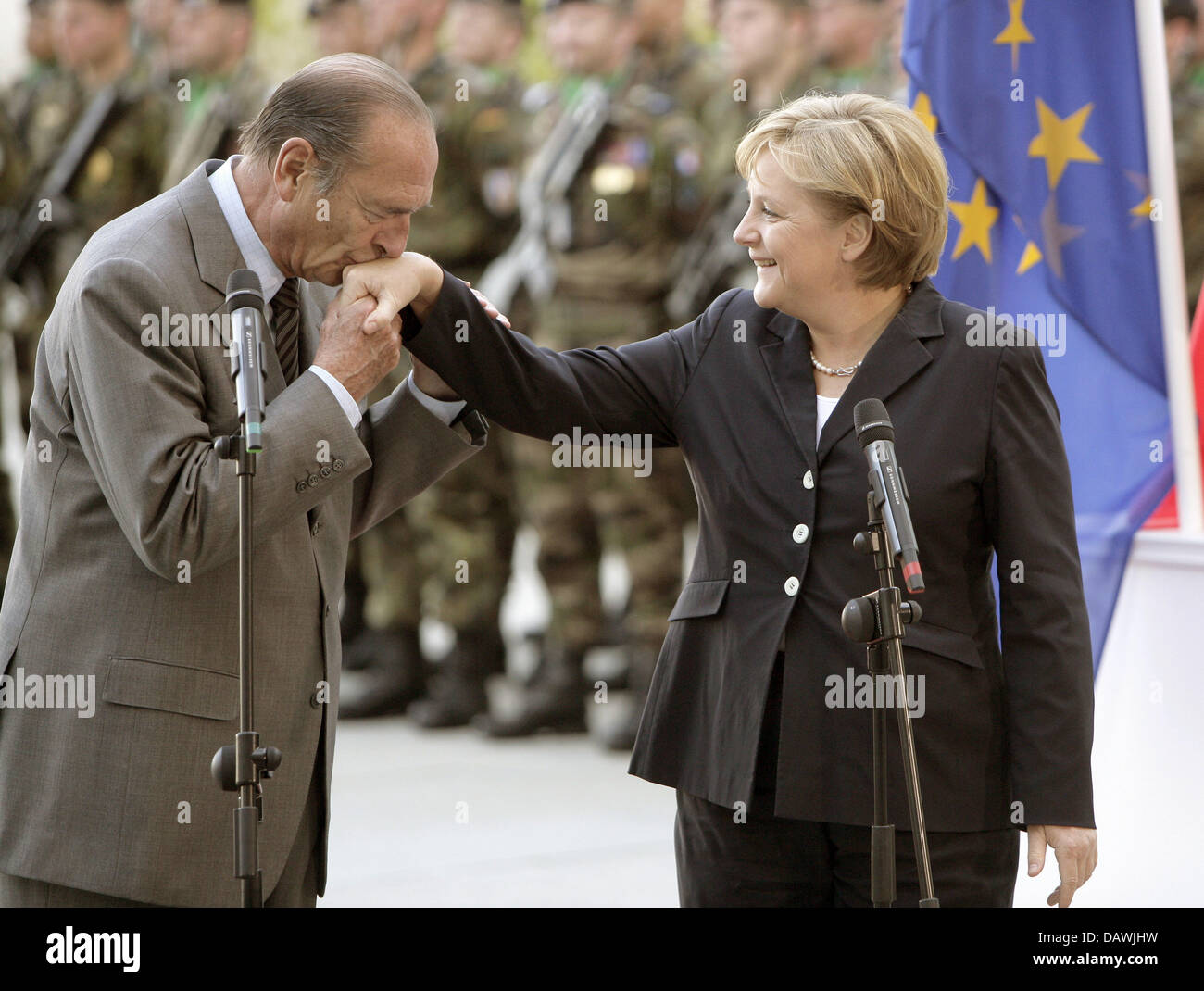 German Chancellor Angela Merkel Has Her Right Hand Kissed By Parting Stock Photo Alamy