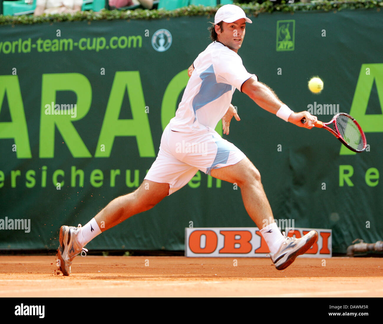 Argentine tennis pro Agustin Calleri stretches to hit a backhand during his World Team Cup match against US James - Stock Image