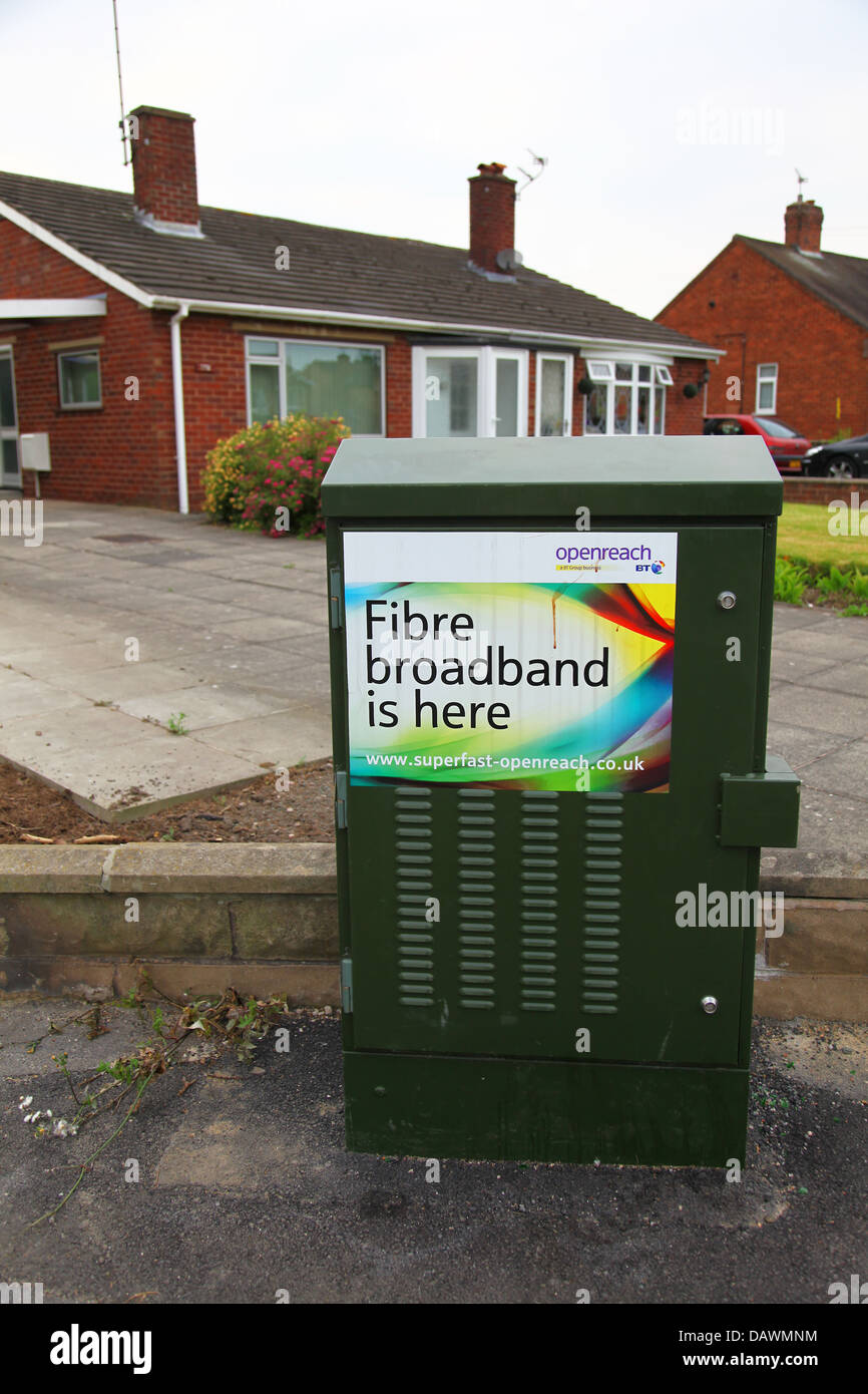 A Btopenreach internet provider fibre optic broadband cabinet in a residential street serving houses with internet - Stock Image