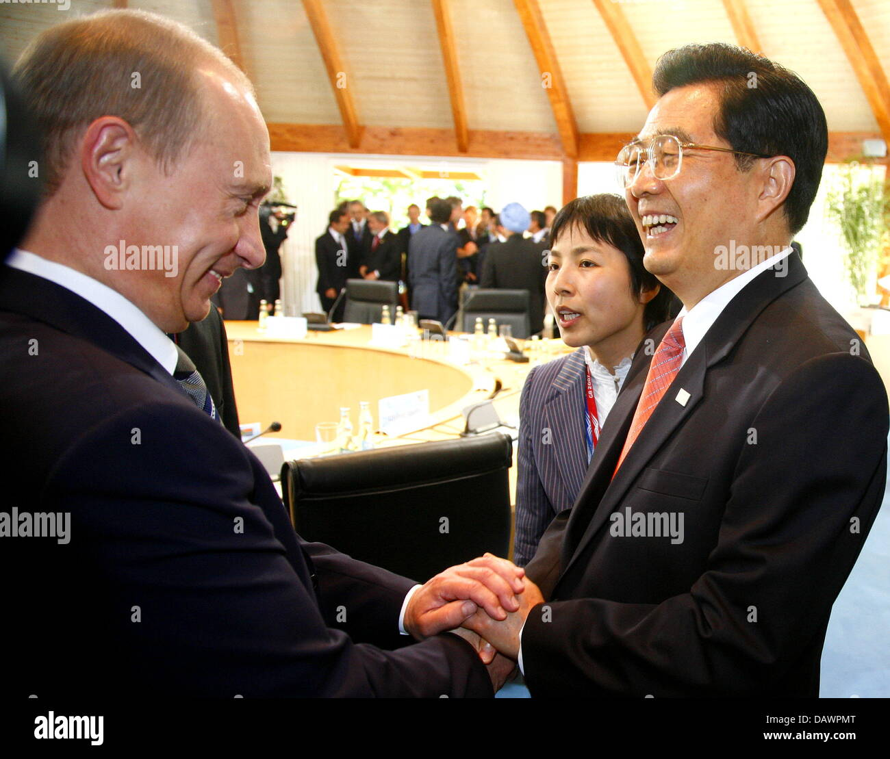 Russian President Vladimir Putin (L) shakes hands with Chinese President Hu Jintao at a session with the so-called Stock Photo