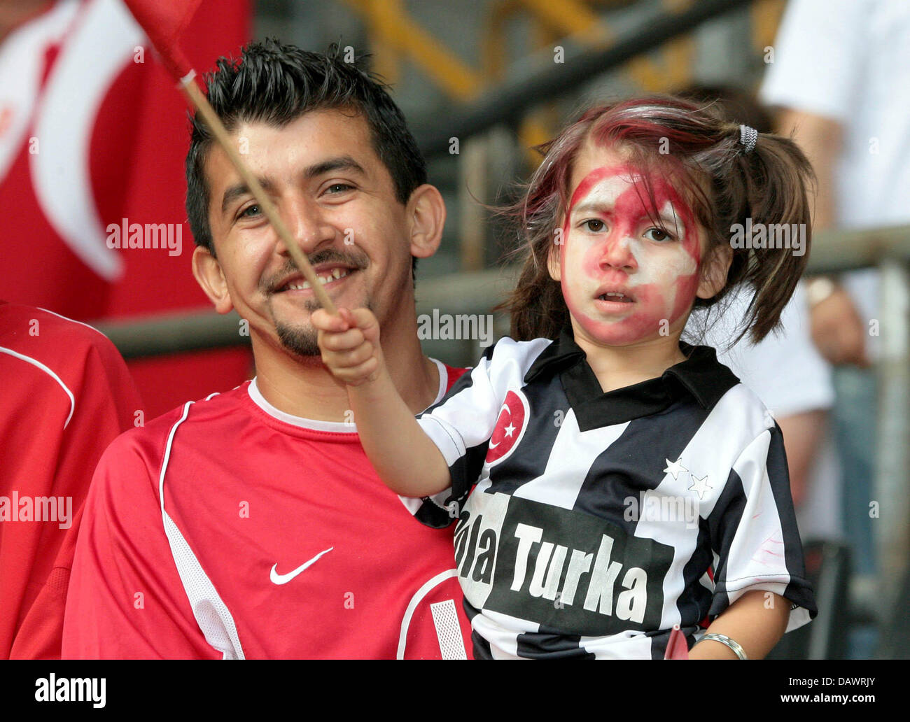 Turkish soccer devotees watch the friendly Brazil v Turkey at the Signal Iduna Park stadium of Dortmund, Germany, - Stock Image