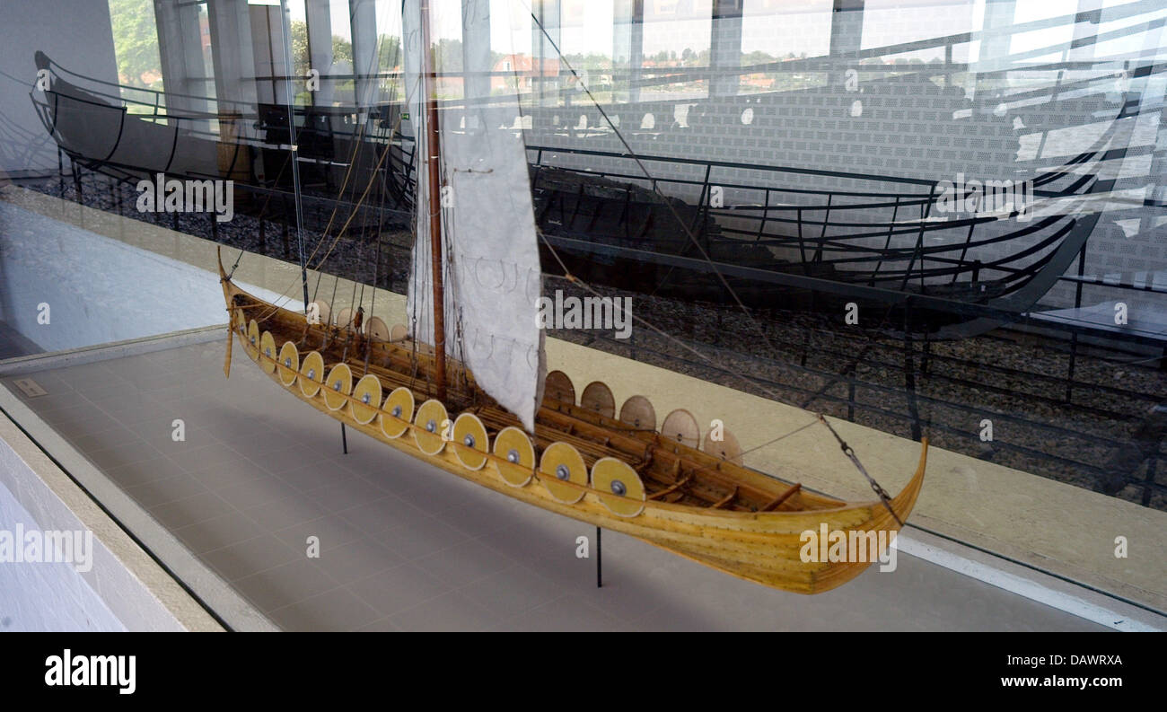 A Viking ship of the 11th century, discoverd in the Roskilde fjord in 1962, and a model of the same ship are presented Stock Photo
