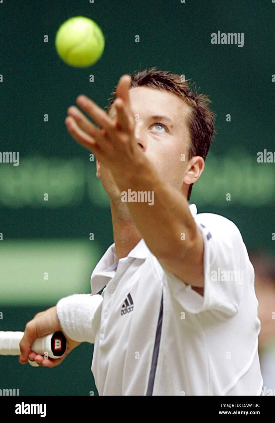 German tennis pro Philipp Kohlschreiber serves a ball during his quarter-finals match against seeded US James Blake Stock Photo