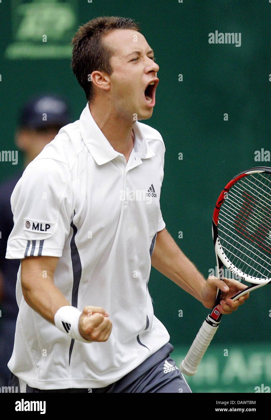 German tennis pro Philipp Kohlschreiber cheers winning his quarter-finals match against seeded US James Blake at Stock Photo