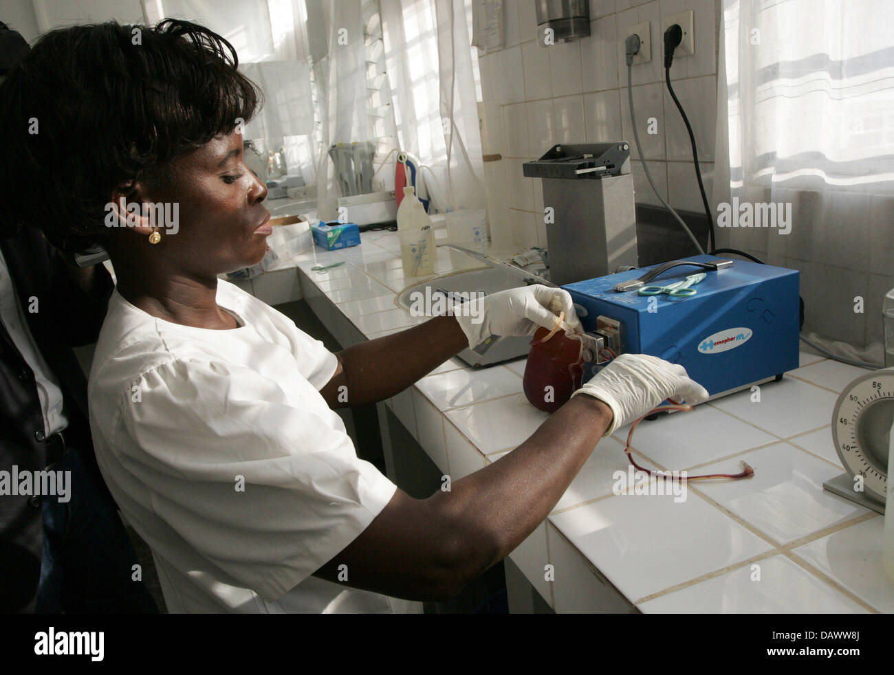 A blood sample is tested on HIV by staff of the National blood-transfusion centre in Kinshasa, DR Congo, 05 May Stock Photo