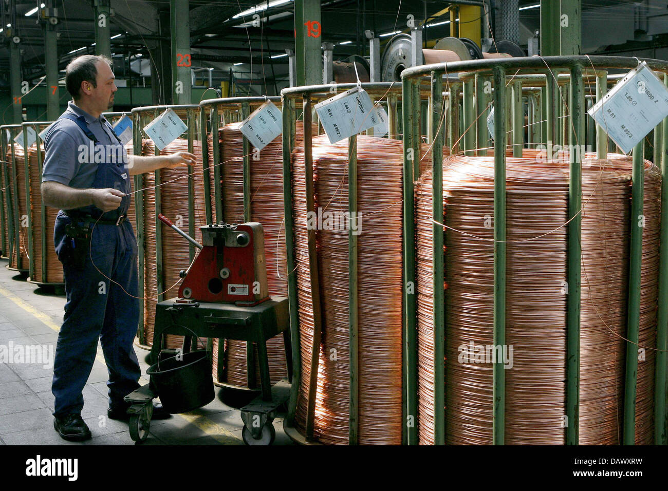 Copper wire spindles wait for furtgher processing at LEONI