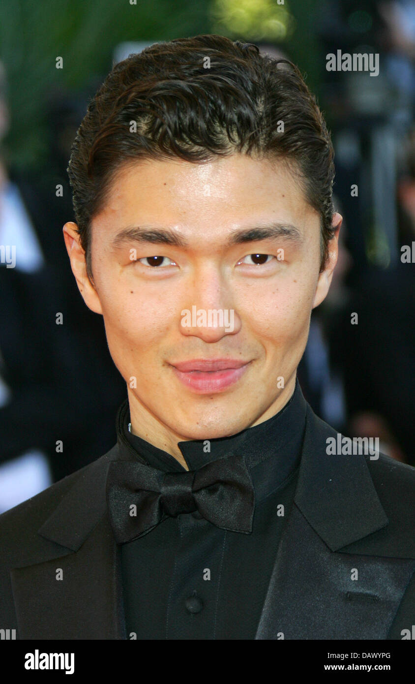 Korean American Actor Rick Yune Poses On The Red Carpet During The