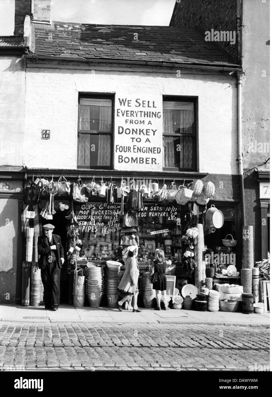 geography / travel, Great Britain, Belfast, trade, general store with slogan: 'We sell everything from a donkey - Stock Image
