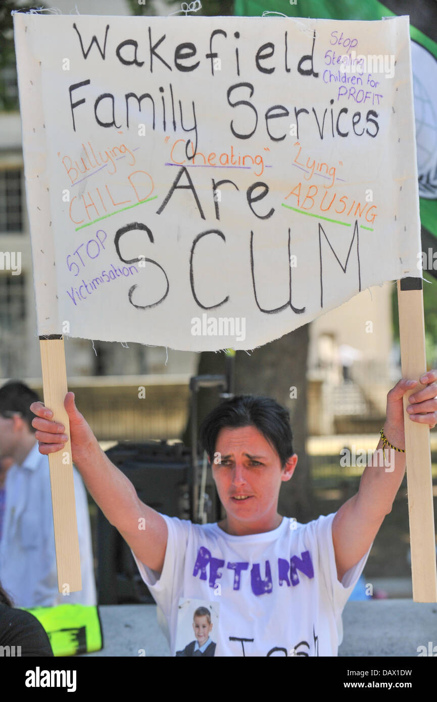 Whitehall, London, UK. 19th July 2013. A woman holds a banner during the S.C.O.T. UK protest outside Downing Street - Stock Image