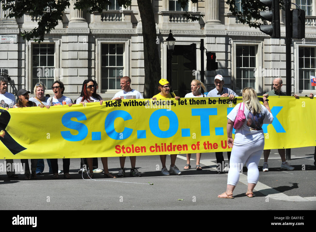 Whitehall, London, UK. 19th July 2013. Members of the group hold a banner at the S.C.O.T. UK protest outside Downing - Stock Image
