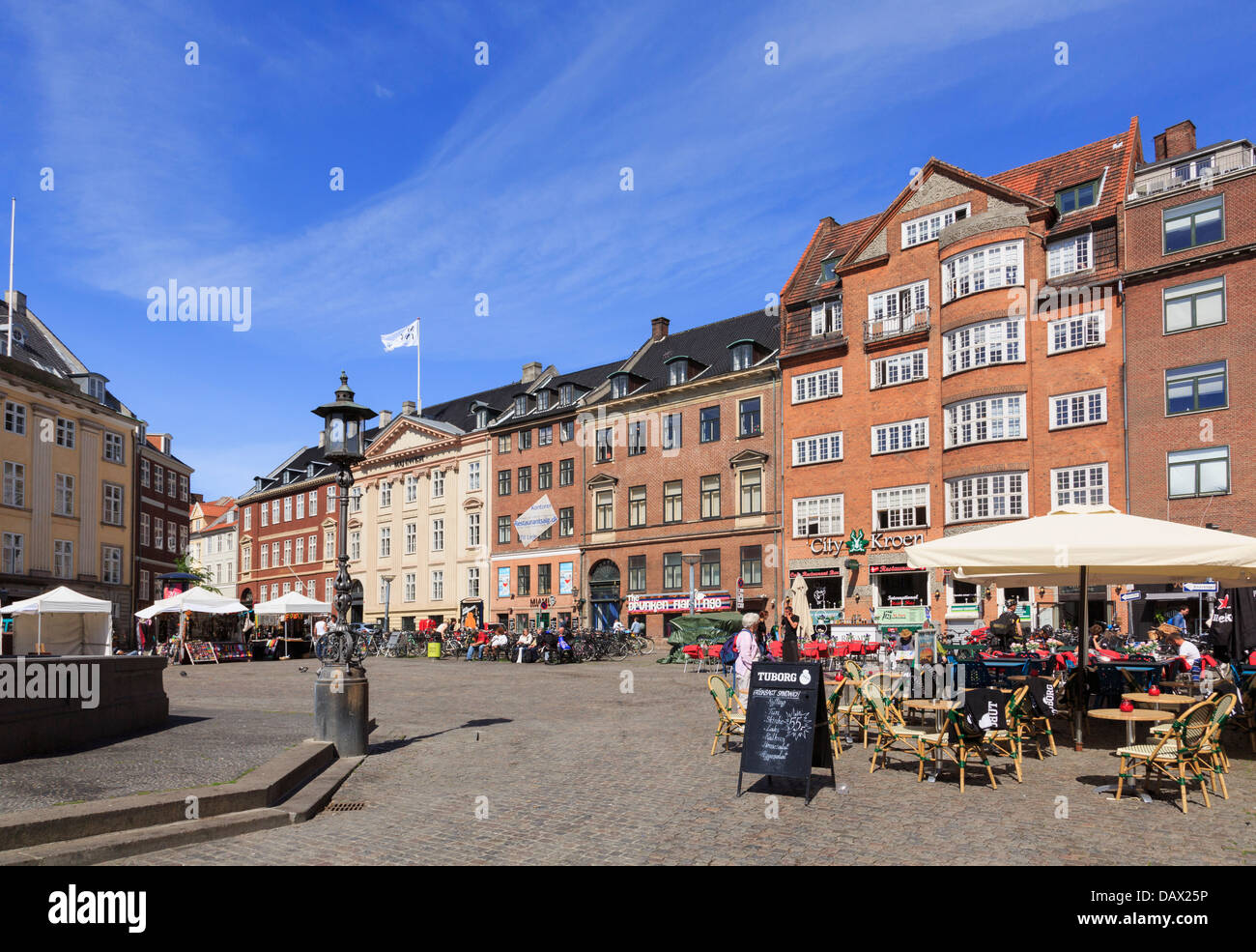 Outdoor street cafés and 18th century Neoclassical buildings in Gammeltorv (Old Square) oldest in Copenhagen, - Stock Image