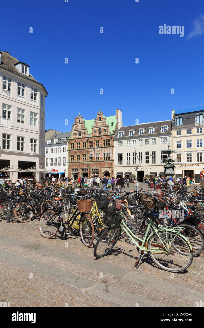 Bicycles parked in Hojbro Plads with old Amagertorv Square beyond. Copenhagen, Zealand, Denmark, Scandinavia - Stock Image