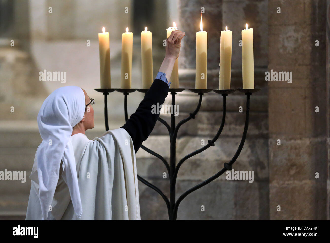 Candles are lit, candle stand in the roman catholic church Gross St. Martin in Cologne, Germany - Stock Image