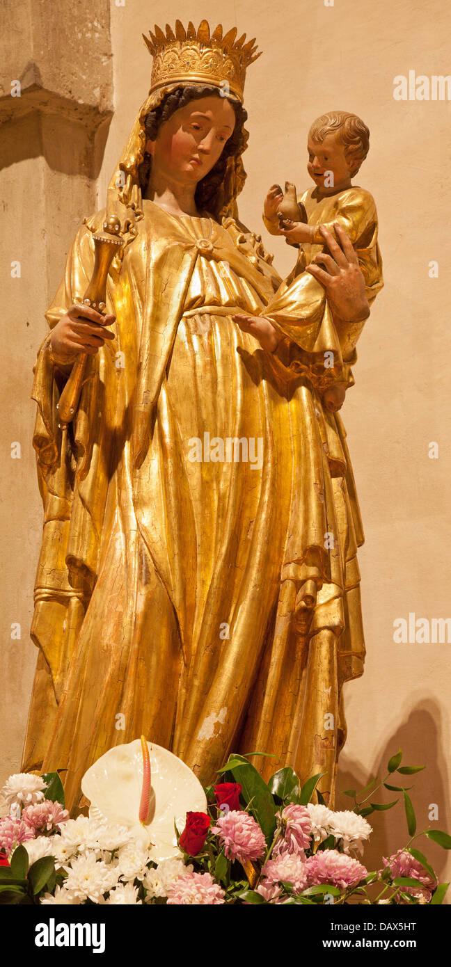 VERONA - JANUARY 27: Gothic polychrome Madonna in st. Thomas church on January 27, 2013 in Verona, Italy - Stock Image