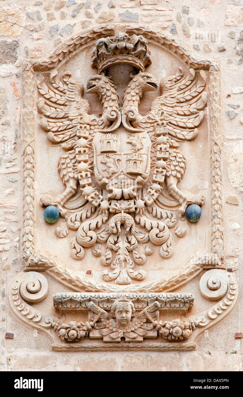 TOLEDO - MARCH 8: Eagle as heraldry of the town on the town walls on March 8, 2013 in Toledo, Spain. - Stock Image