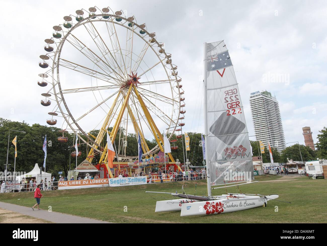 A giant wheel rotates at the opening of the 124th Travemuende Week in Travemuende, Germany, 19 July 2013. The festival - Stock Image