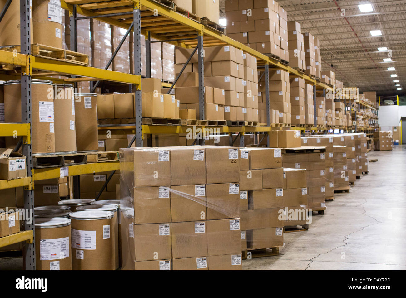 an industrial warehouse full of cardboard boxes on shelving stock rh alamy com warehouse boxes and boogies exeter warehouse boxes exeter