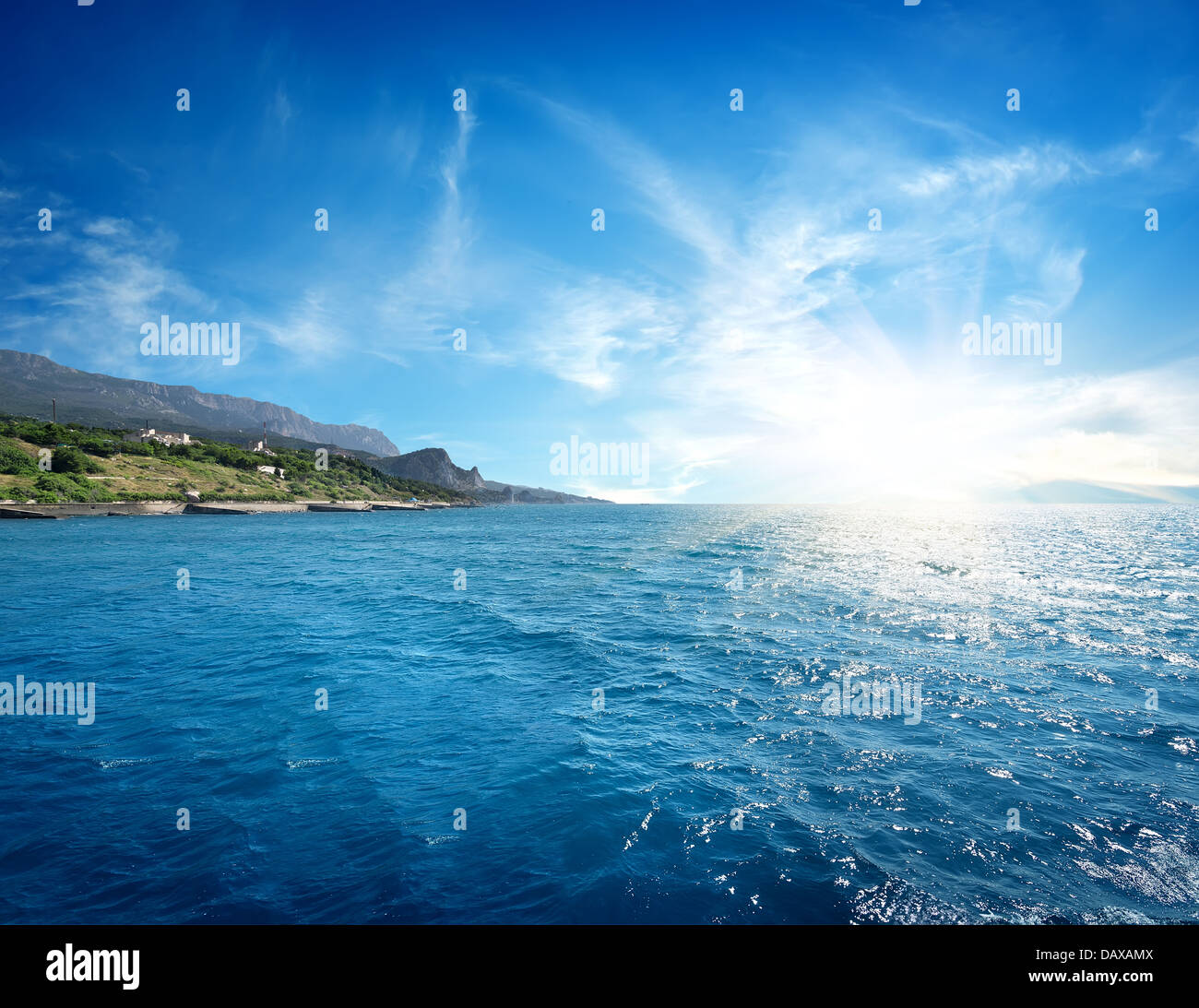 The morning sun rises from the sea - Stock Image
