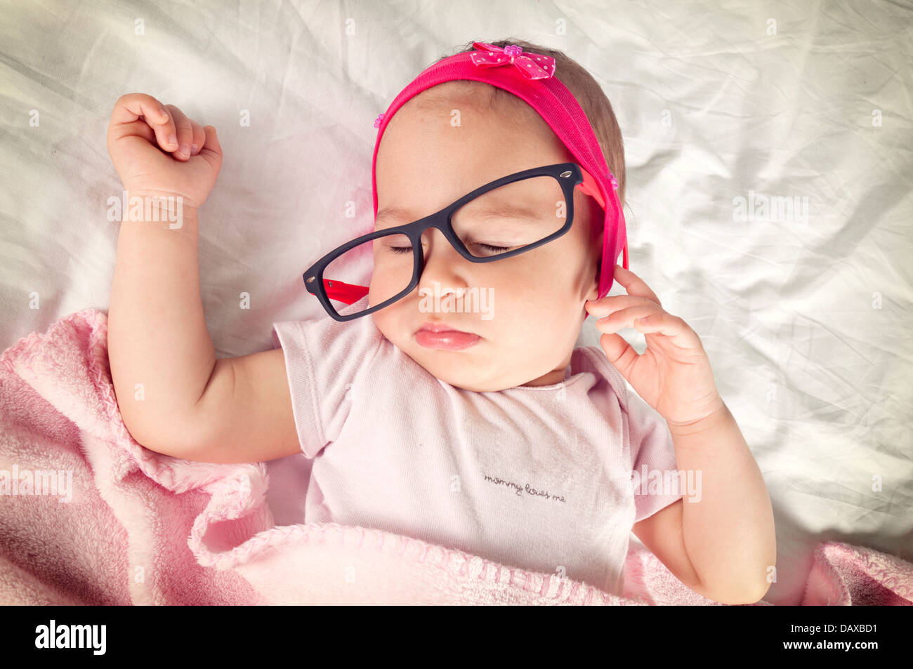 Funny Sleepy Baby With Eyewear On Her Head Stock Photo Alamy