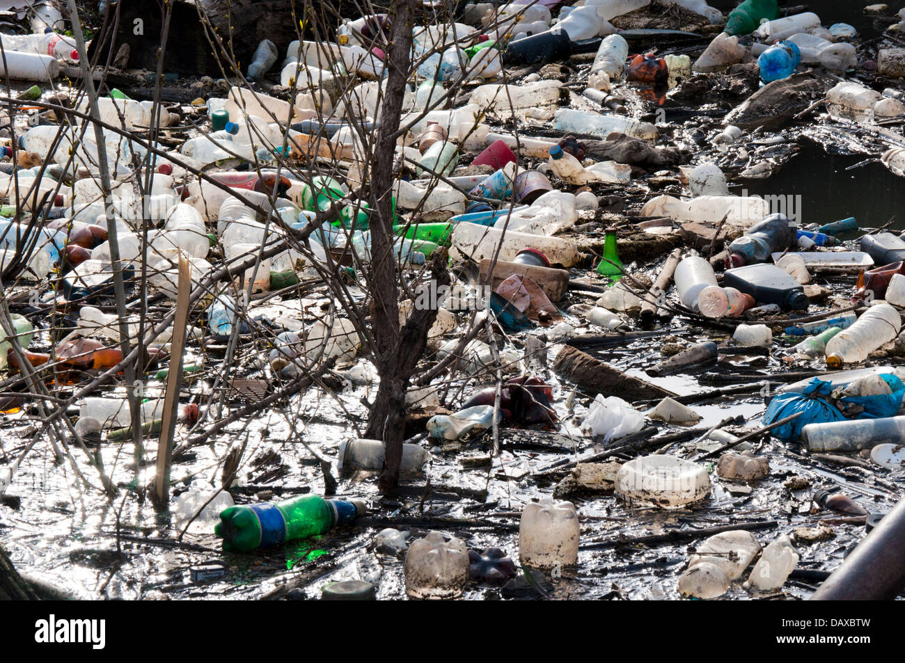 Water pollution with large group of junk - Stock Image