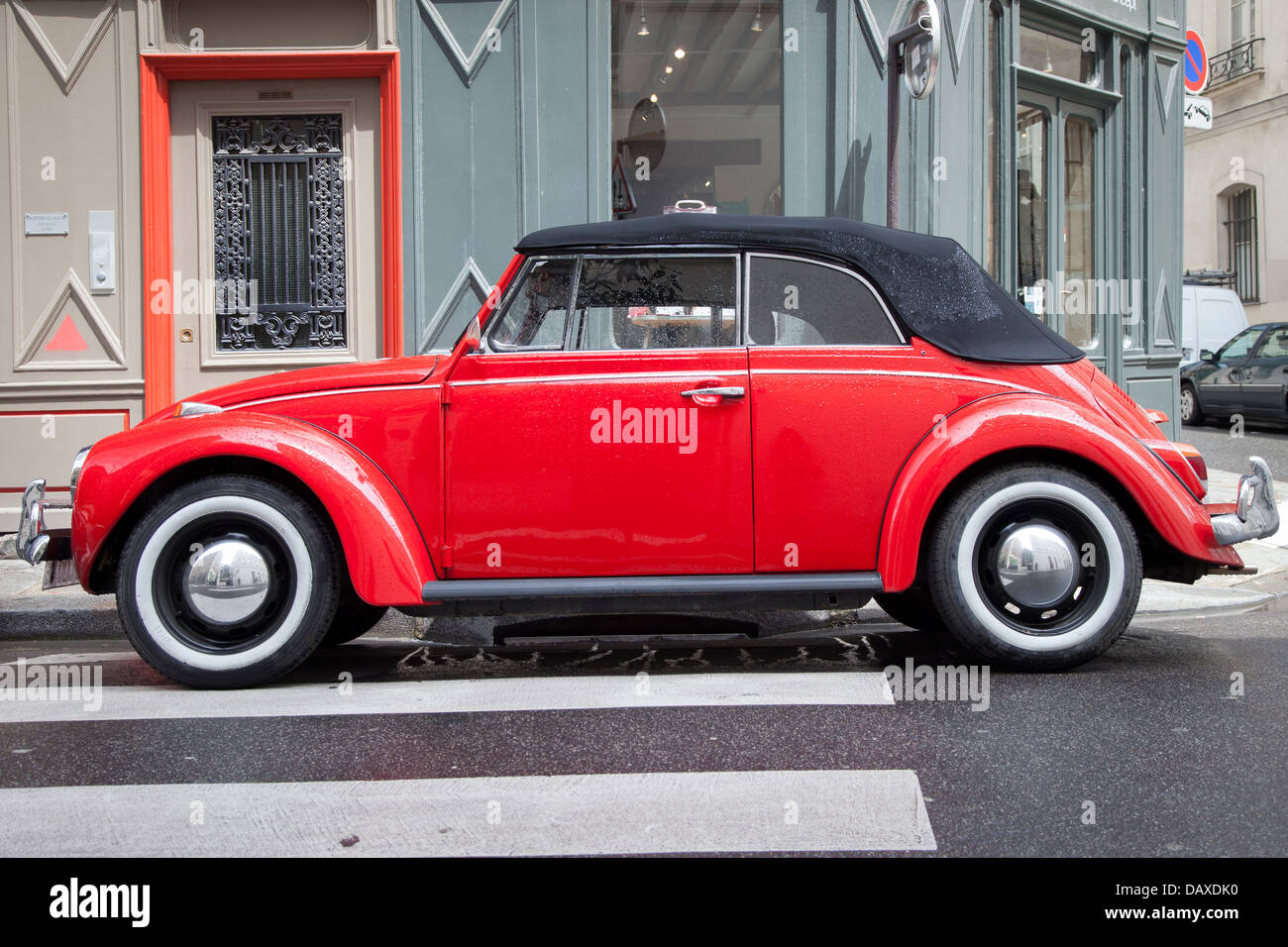 Red Volkswagen Beetle parked in front of consignment shop in the ...