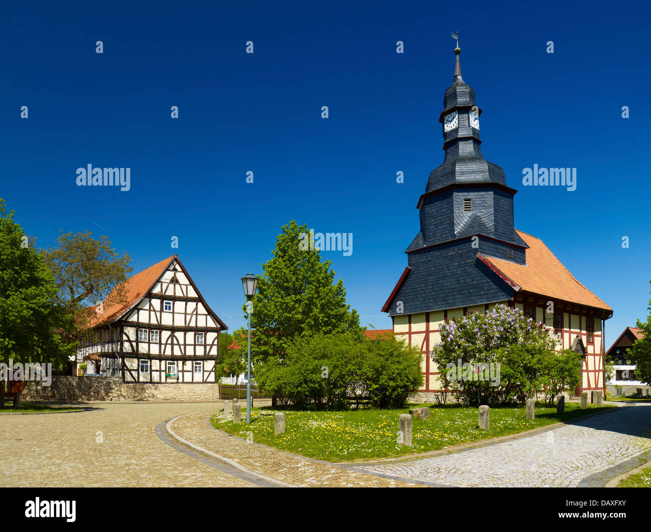 St. Trinity Church Hauröden and half-timbered house, Eichsfeld District, Thuringia, Germany - Stock Image