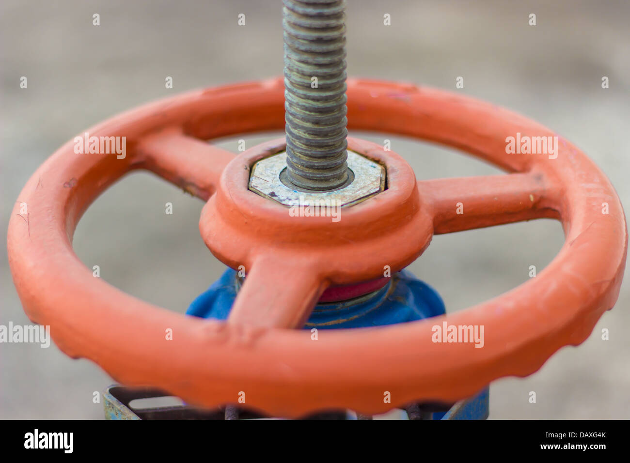 close-up red gate valve and screw - Stock Image