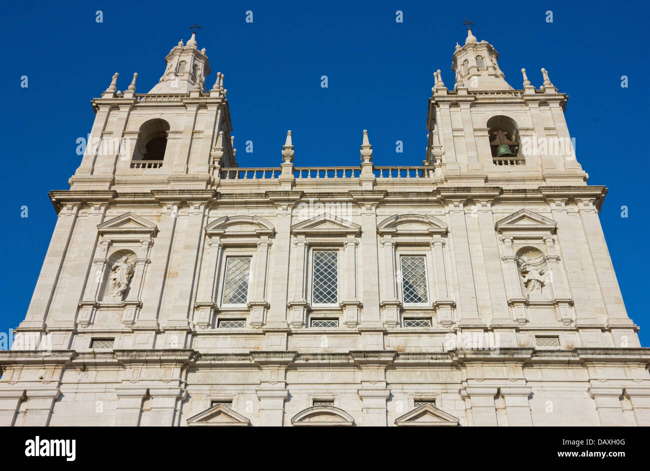 Monastery of Sao Vicente de Fora in Lisbon, Portugal. Facade shot over clear blue sky. Stock Photo