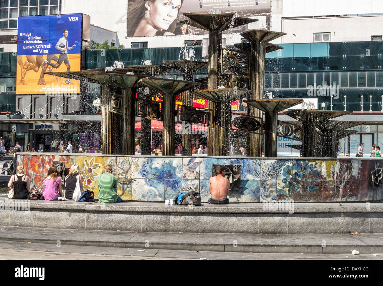 People cooling off at the 'Fountain of International Friendship' during the heatwave - Alexanderplatz, Mitte, - Stock Image