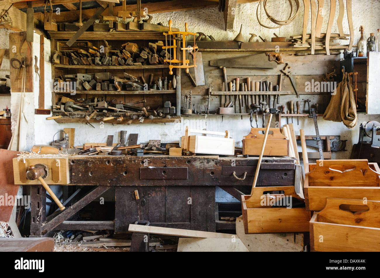 Old carpenters workshop with tools and finished products - Stock Image