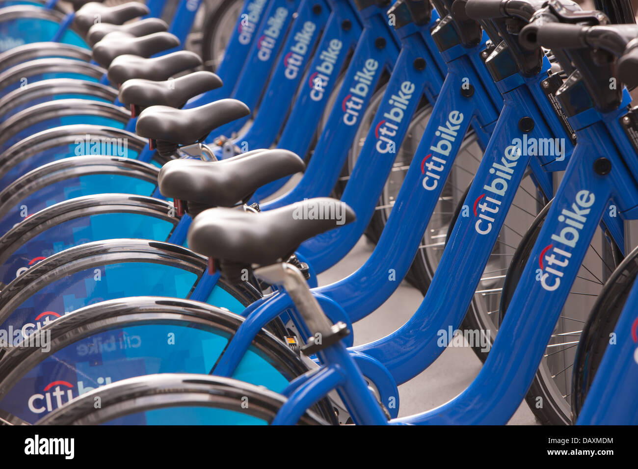 Public bicycles of the Citi Bike NYC bike sharing program wait in their docking stations for the next riders. - Stock Image
