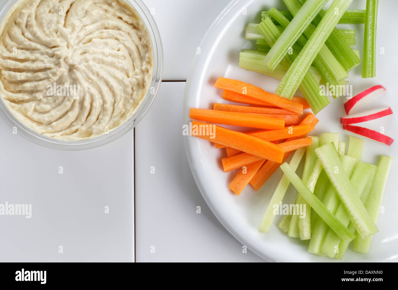 Houmous or Hummus with fresh vegetables - Stock Image