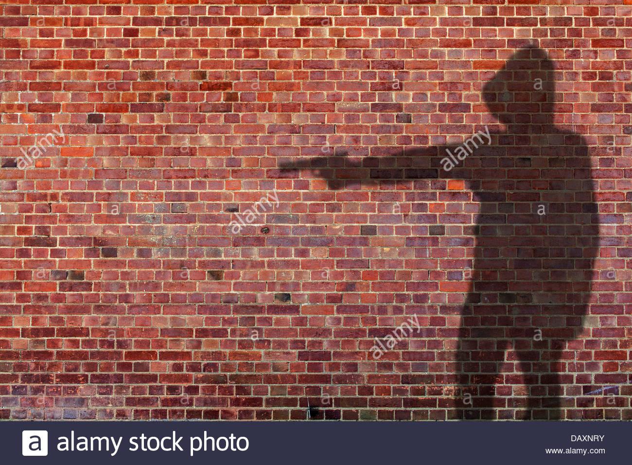 gun man shadow - Stock Image