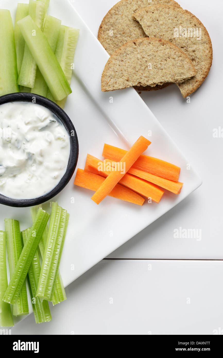 Tzatziki with fresh vegetables and oatcakes - Stock Image