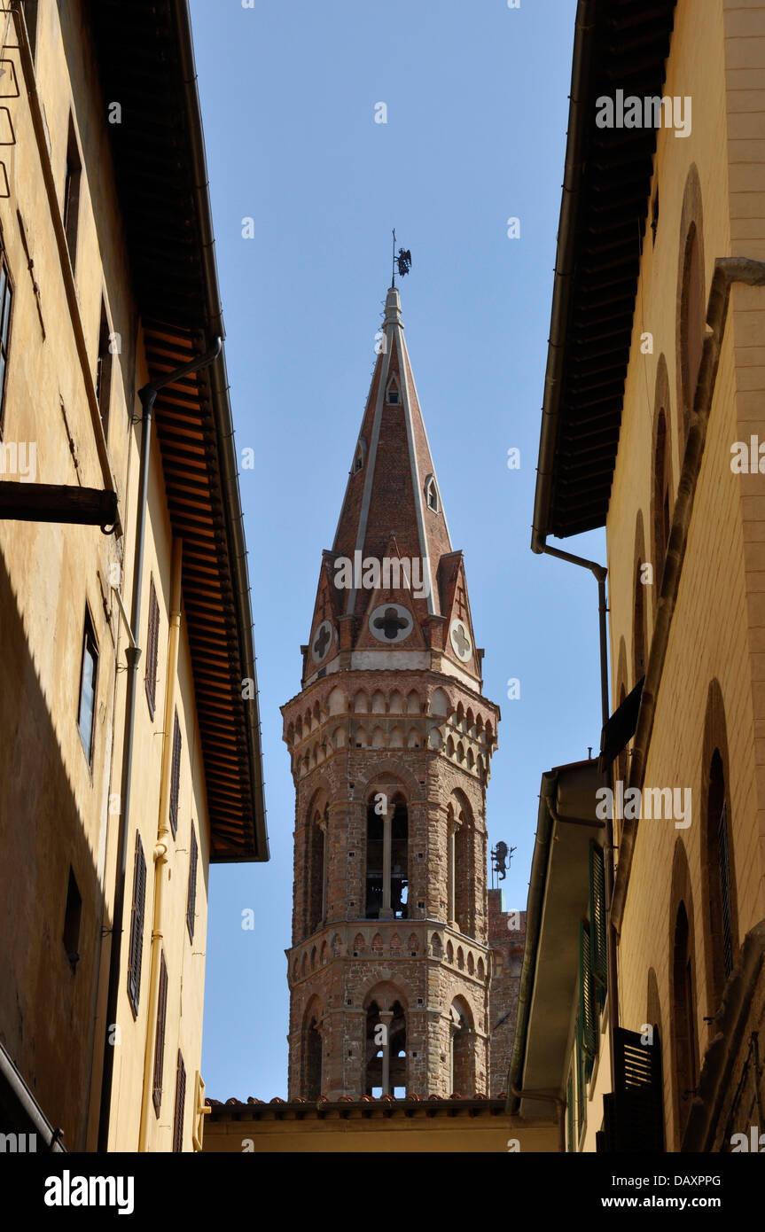 The tower of Badia Fiorentina. The 'abbey' church from a narrow street, Florence, Italy, Europe Stock Photo