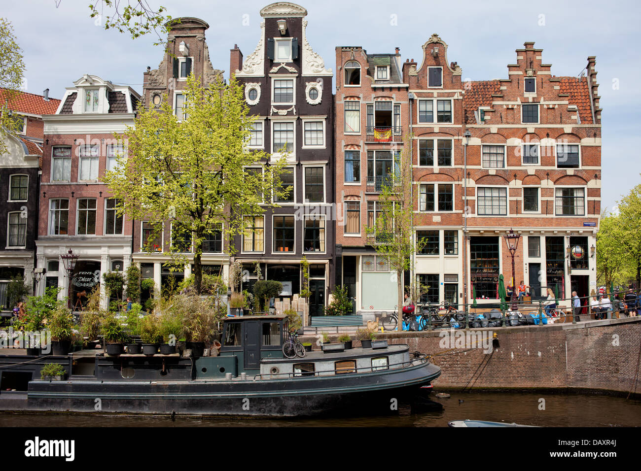 Houses, Dutch style apartment buildings along Prinsengracht canal in the city of Amsterdam, Netherlands. - Stock Image
