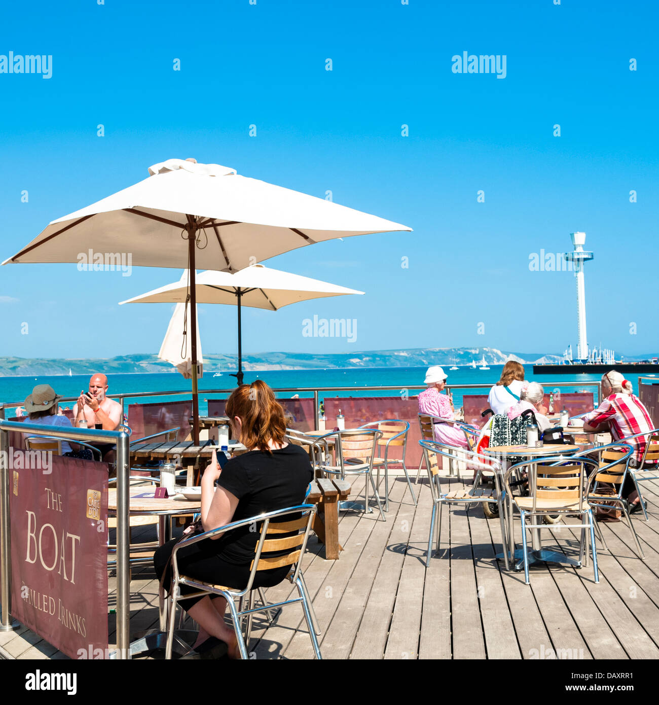 Cafe on the beach at Weymouth with the sealife tower in the background, Dorset, UK. - Stock Image