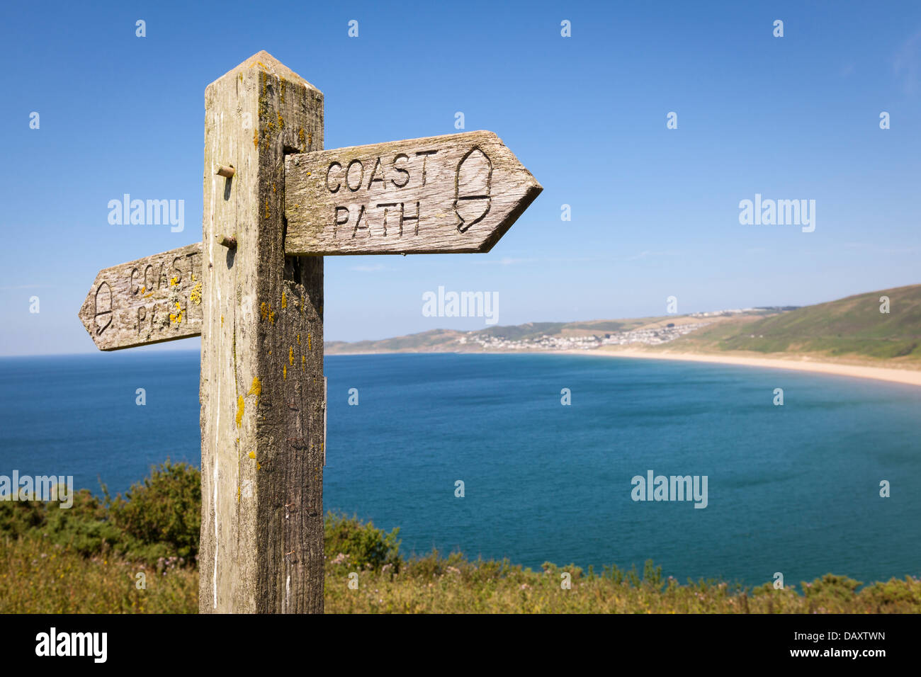 Coastal path with a sign, alongside Woolacombe beach in Devon, England. - Stock Image