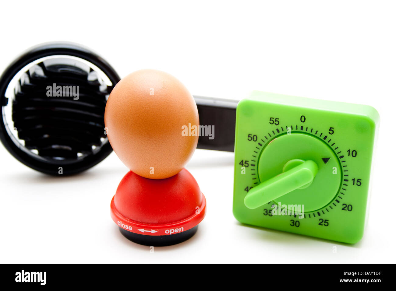 Egg timer with egg - Stock Image