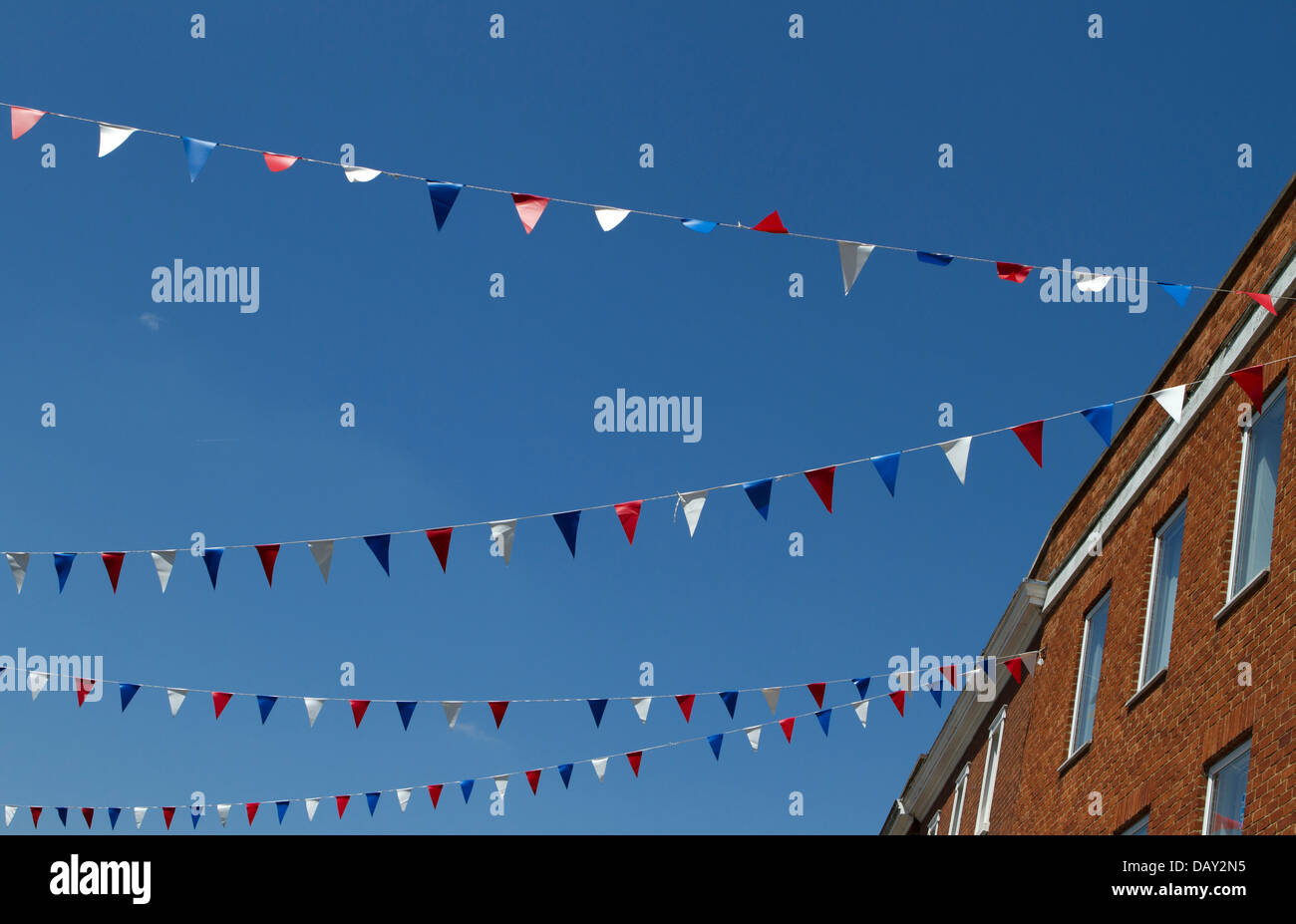 Bunting against a blue sky. - Stock Image