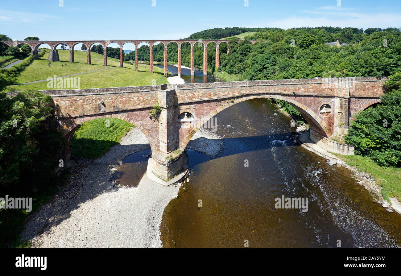 Disused Leaderfoot Railway Viaduct at River Tweed near Newstead in Scottish Borders Scotland with the old A68 road - Stock Image